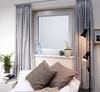 Wohnraum im Keller mit Lichtschacht-Fenster