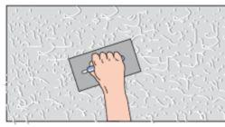 Dekor-Putz auf Bauwerksuntergrung aufragen